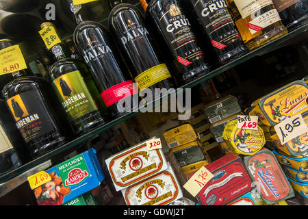 Bottles of Porto wine and more typical Portuguese products on sale in a grocery store, Porto, Portugal - Stock Photo
