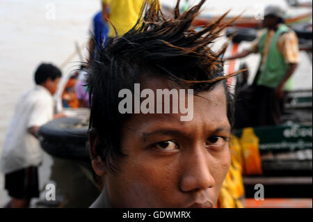 Portrait of a boat boy - Stock Photo