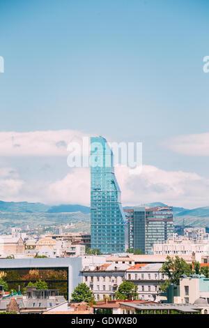 Tbilisi, Georgia - May 19, 2016: Radisson Blu Hotel On Background Of Urban Cityscape Of Tbilisi, Georgia - Stock Photo