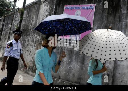 Bodybuilding poster behind umbrellas - Stock Photo