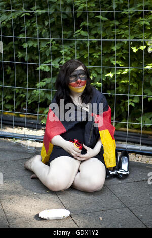 Young woman sits on the German Fan Mile at the World Cup in Berlin, Germany, 2010 - Stock Photo