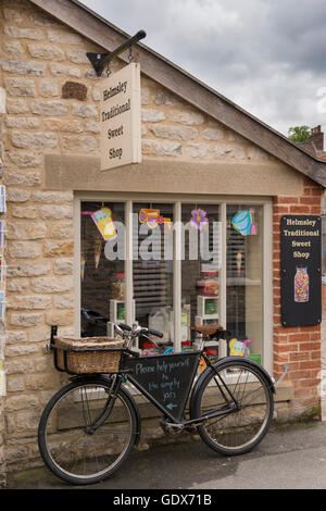 Helmsley Traditional Sweet Shop, Helmsley, North Yorkshire - sweet jars in the window and old fashioned delivery - Stock Photo