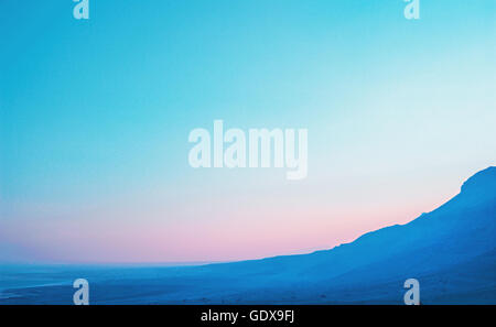 Colorful landscape with blue-pink and cloudless sky in Israel - Stock Photo