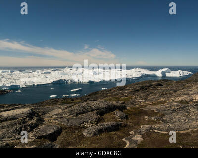 Ilulissat icefjord fed by Sermeq Kujalleq glacier Ililissat is a town in Qaasuitsup municipality in western Greenland - Stock Photo