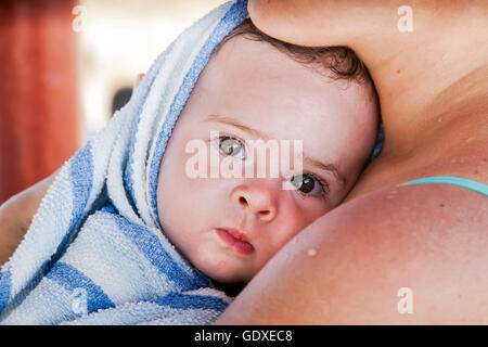 Mother and baby closeup portrait, family picture, adorable small girl - Stock Photo