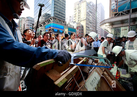 Police Continue Efforts To Clear Hong Kong Protest Sites - Stock Photo