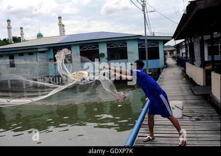 Fisherman in the Kampong Ayer Water Village - Stock Photo