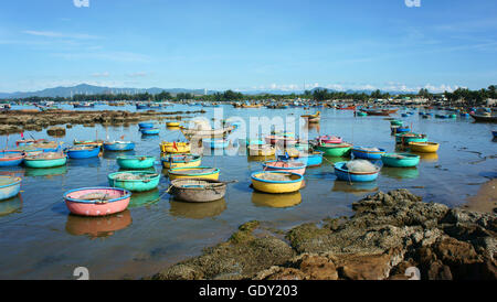 Great landscape of Asian country, colorful Vietnamese beach with group of vibrant coracle on seaside, amazing for - Stock Photo