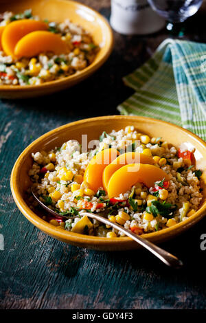 Plates of refreshing summer bulgar salad with fresh vegetables - Stock Photo