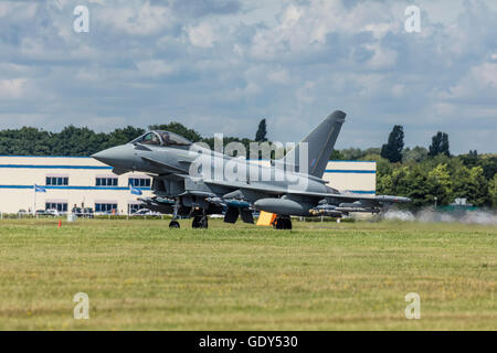 RAF Eurofighter Typhoon plane takes off from the runway at the Farnborough International Air Show 2016 - Stock Photo