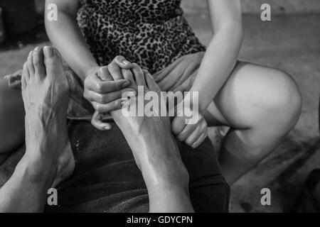 Foot spa, close up detail of feet being massaged,Chiang Mai,Thailand - Stock Photo
