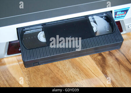 VHS blank casette tape in a VHS player - Stock Photo