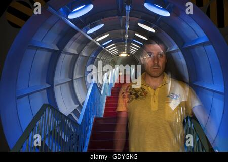 Inside the spheres and tubes of the Atomium. The Atomium monument designed by André Waterkeyn, Brussels, Belgium, - Stock Photo