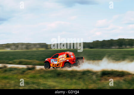 rally car Chinese team goes on road during Silk way rally - Stock Photo