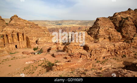 The Monastery Al Deir in Petra, Jordan, The valley around Petra in the background - Stock Photo