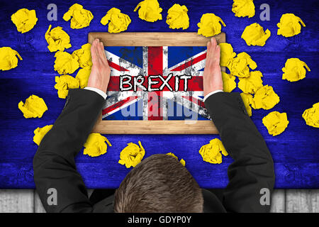 brexit concept on blue table with yellow paper snarls  politican and brexit chalkboard - Stock Photo