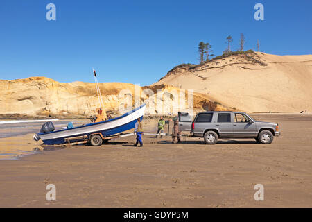 A Dory Fisherman Stands Near His Boat On The Beach At