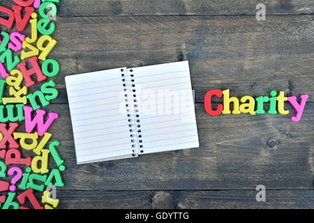 Charity word on wooden table - Stock Photo
