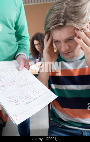 Sad university student looking at his test result, Bavaria, Germany - Stock Photo