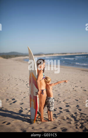Boy showing something to his mother at the beach, Viana do Castelo, Norte Region, Portugal - Stock Photo
