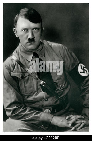 1930's informal B&W portrait of Adolf Hitler with swastika armband and German military iron cross badge - Stock Photo