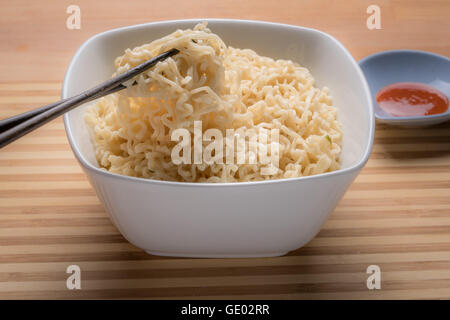 Ramen Instant Noodles Isolated in White Bowl - Stock Photo