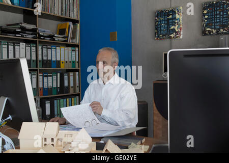 Senior businessman working in the office, Freiburg im Breisgau, Baden-Württemberg, Germany - Stock Photo