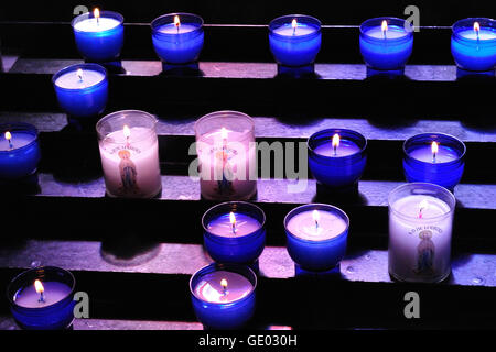 Candles in the Rosary Basilica in Lourdes for the Notre Dame Saint Mary. - Stock Photo
