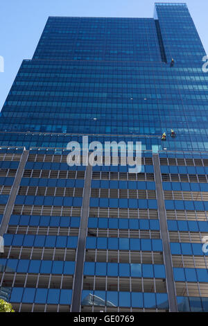 Window cleaners at work at Portside Tower, currently the tallest building in Cape Town, South Africa. - Stock Photo