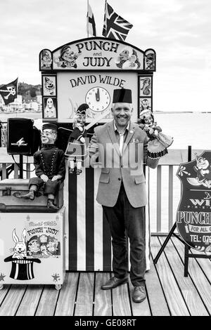 Children's Entertainer David Wilde With His Punch and Judy Puppets, Hastings Pier, Hastings, Sussex, UK - Stock Photo