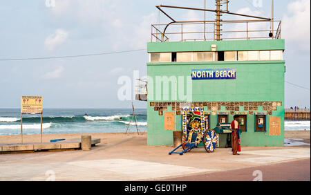 DURBAN, SOUTH AFRICA - AUGUST 17, 2015: Rikshaw at the North Beach lifesaver's station on The Golden Mile promenade - Stock Photo