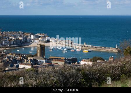 View over harbour and Smeatons Pier with St Ia's church, St Ives, Cornwall, England, United Kingdom, Europe - Stock Photo