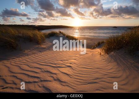 Ribbed sand and sand dunes at sunset, Crantock beach, Crantock, near Newquay, Cornwall, England, United Kingdom, - Stock Photo