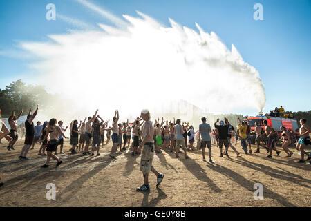 People enjoying water curtain on the 9th Przystanek Woodstock (Woodstock Festival). - Stock Photo