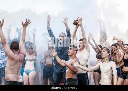 People enjoying water curtain at the19th Przystanek Woodstock (Woodstock Festival). - Stock Photo