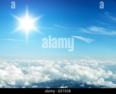 Aerial view of clouds and landscape under them. - Stock Photo