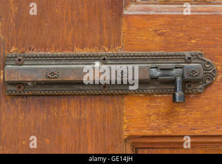 retro hasp on old wood door in house - can use to display or montage on products - Stock Photo