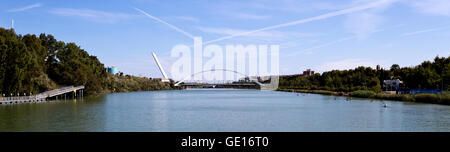 View of the Guadalquivir River with the spar cable-stayed of the Alamillo bridge behind the Barqueta Bridge in Seville, - Stock Photo