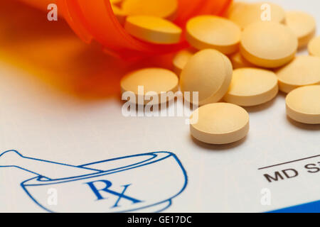 Orange Pills Spilled on RX Medicine Prescription Doctors Note. - Stock Photo