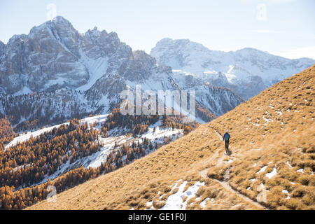 Woman hiking in the Dolomite Mountains, South Tyrol, Italy - Stock Photo