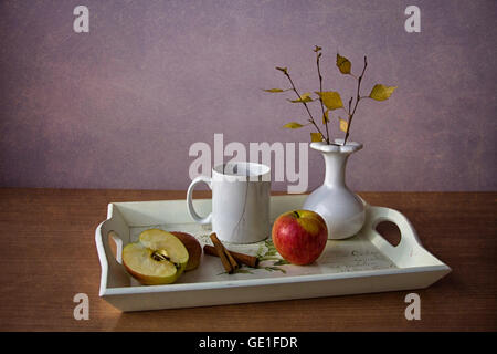 Apples, cinnamon and cup of coffee on a tray - Stock Photo