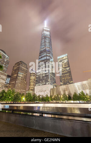 New York, USA - September 13, 2015: Night picture of The National September 11 Memorial pool and Freedom Tower. - Stock Photo