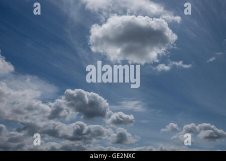 Beautiful white cumulus and cirrus clouds on blue sky - Stock Photo