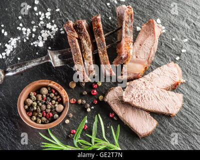 Steak Rib eye with spices on the graphite tray. - Stock Photo