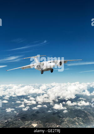 Airplane over the clouds. - Stock Photo