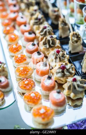 Assortment of canapés. Banquet service. - Stock Photo