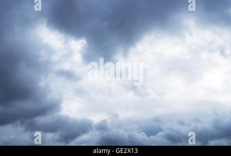 Heavy gray clouds in the sky before snow falling. - Stock Photo