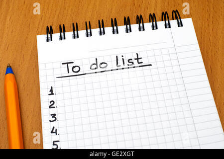 Words To do list written on white notepad with ballpoint pen on table. - Stock Photo
