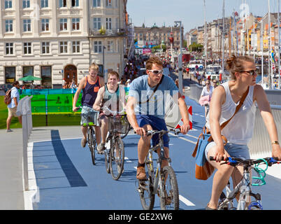 Cyclists or cyclers on the new pedestrian and cyclist bridge Inderhavnsbroen, Inner Harbour Bridge, connecting Nyhavn - Stock Photo