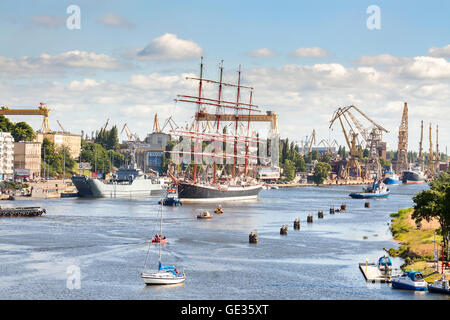 Russian Sedov, one of the biggest participating sailing ships is about to leave the harbor. - Stock Photo